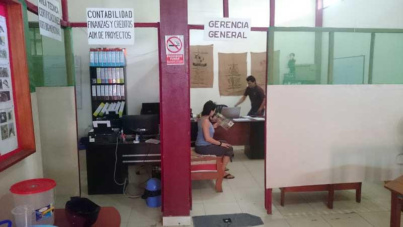 Tereza sits in the admission office.