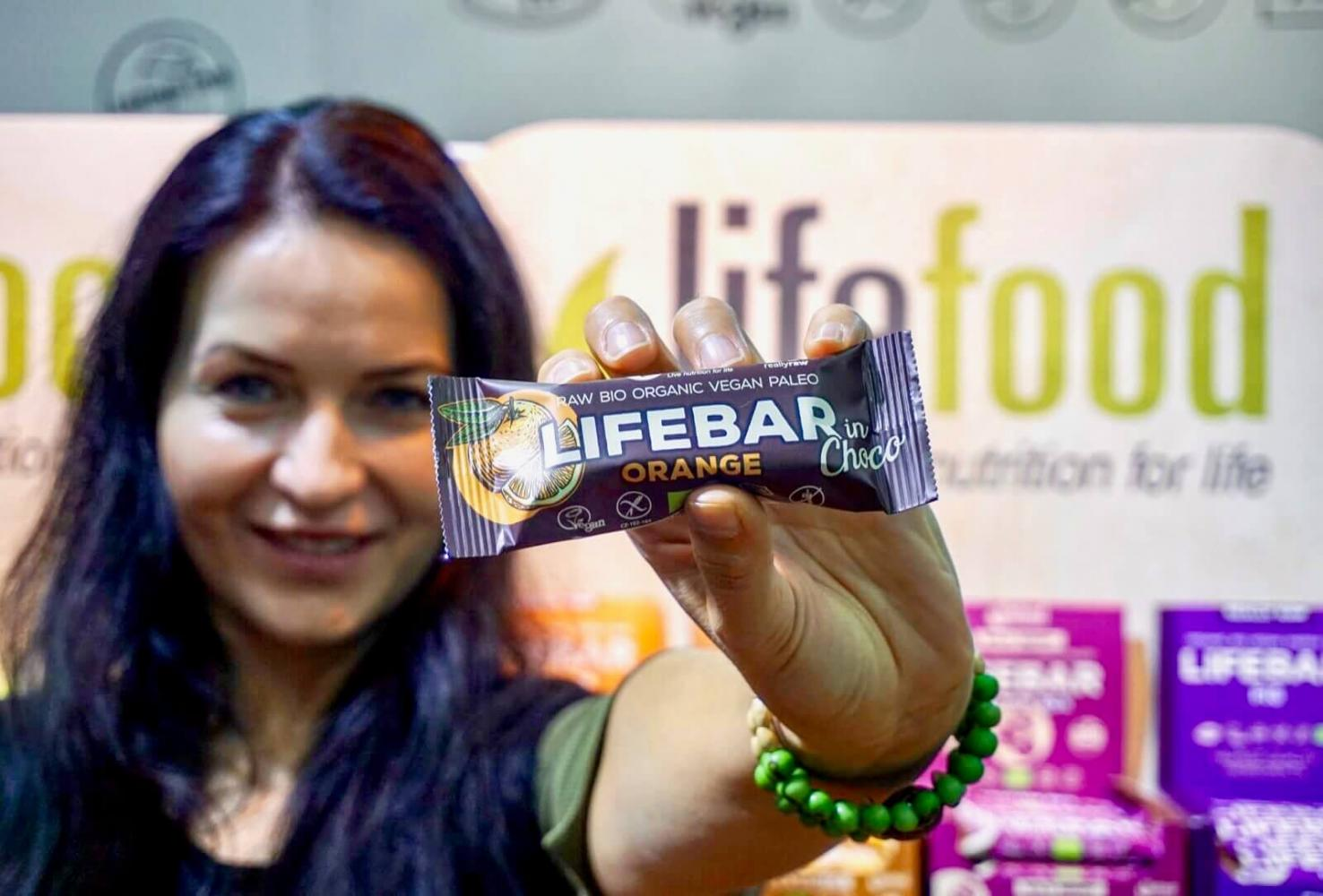 Lifefood owner Tereza is showing a new product - Lifebar coated with chocolated